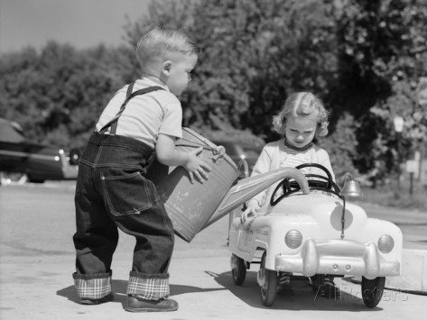 h-armstrong-roberts-1950s-little-boy-playing-gas-station-pouring-water-into-toy-car-for-little-girl