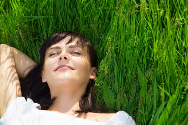 woman-relaxing-in-the-grass
